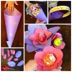 [Image Description: Five images detailing the steps required to make May-Day basket gifts. In the first image, a child's hand rolls a piece of construction paper into a cone, leaving a large flap at the top. In the second, a construction paper handle has been attached to the wide top of the cone, and popcorn has filled it. In the third, the extra flap at the top has folded over the opening, forming a lid. In the fourth picture, oblong petals of different sizes have been cut out of construction paper. In the final image, the petals have been threaded on the sticks of lollypops, forming flowers.]