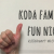 "Image Description: a white hand signs ""10"" against a white background. White text reads ""Koda Family Fun Night"" and ""KODAheart #k3famILY"""