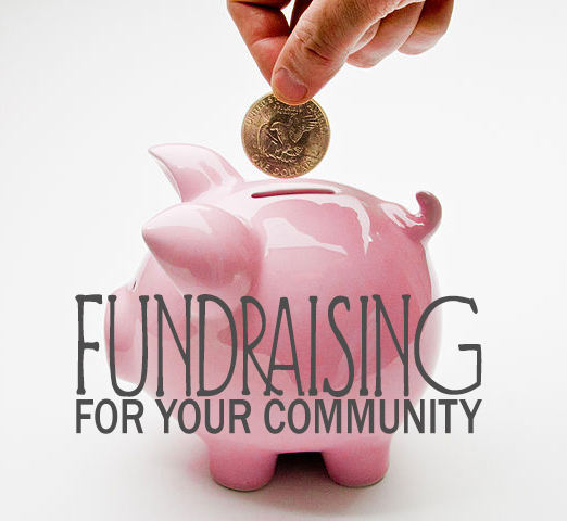 "[Image description: In the background, a hand lowers a gold coin into a shiny, pink piggy bank. In the foreground, overlaid text reads, ""Fundraising For Your Community.]"