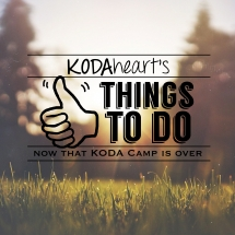 "[Image Description: A thumb, outlined in black, signs ""10"" with accompanying text that reads: ""KODAheart's [10] things to do now that koda camp is over"". In the background is an image of a grassy field. Soft sunlight breaks through trees, lighting the grasses from behind.]"