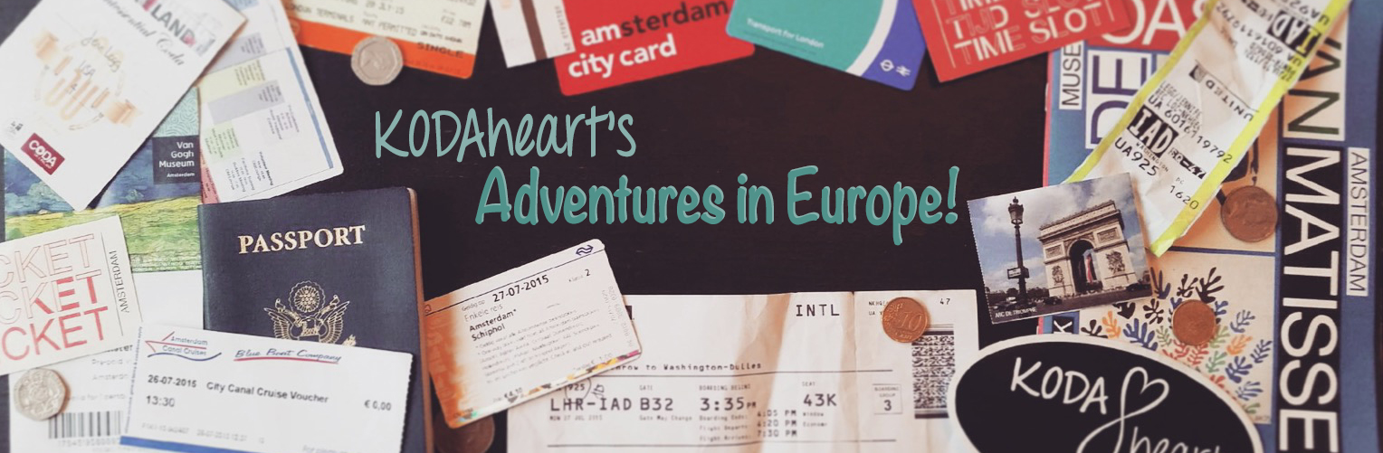 """Image Description: [ """"KODAheart's Adventures in Europe!"""" Is written in teal on a black background surrounded by various travel tickets and passes. A passport and a KODAheart sticker are on the left and right sides of the image respectfully.]"""