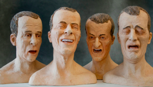 [Image description: Four bust sculptures of white middle aged men are displaying various emotions. The first on on the left bust depicts a man with his mouth slightly ajar. The second figure shows a man displaying a laugh, while the last two busts shows the emotions of anger and sadness.]