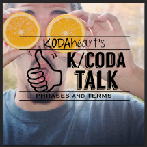 "[Image Description: In the image a thumb, outlined in black, signs ""10"" with accompanying text that reads: ""KODAheart's [10] K/Coda talk phrases and terms"" . A man wearing a grey t-shirt, holding two halves of an orange in front of his eyes. He has a shocked expression. Behind him trees with fall leaves are visible.]"