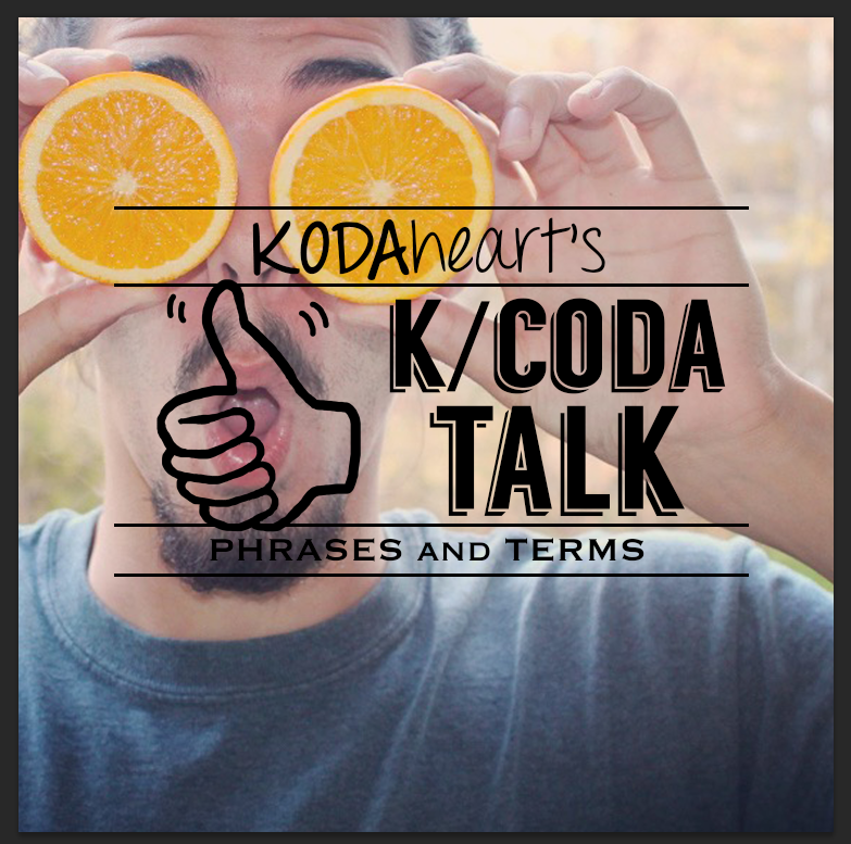 """[Image Description: In the image a thumb, outlined in black, signs """"10"""" with accompanying text that reads: """"KODAheart's [10] K/Coda talk phrases and terms"""" . A man wearing a grey t-shirt, holding two halves of an orange in front of his eyes. He has a shocked expression. Behind him trees with fall leaves are visible.]"""