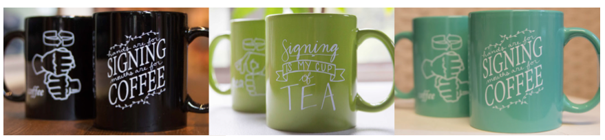 """[Image description: Three different colored mugs are lined up. Each mug has a visible front and back. The first mug is black and has the words """"Hands are for signing, mouths are for coffee"""". Behind it is the back side of the mug, printed is the ASL sign for """"coffee"""". The second mug is green with the words """"Hands are for signing, mouths are for tea"""". Behind it is the back side of the mug, printed is the ASL sign for """"tea"""". The third mug is teal and has the words """"Hands are for signing, mouths are for coffee"""". Behind it is the back side of the mug, printed is the ASL sign for """"coffee"""".]"""