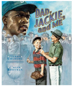 """Image description: """"Dad jackie and me"""" is the title of this book showing a group of people in 1970's clothing and a young boy wearing a baseball mit. In the upper left hand of the photo a portrait of a Black man wearing a baseball cap sits behind the crowd of men in top hats."""
