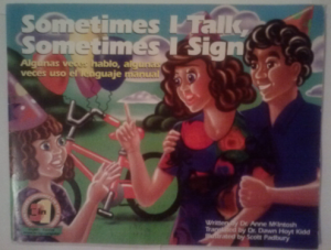 """Image Description:""""Sometimes I talk, Sometimes I sign"""" is the title above a woman and man facing a young girl who is wearing a birthday hat. in the background is a bike with balloons attached the the handle bars. The woman and girl have their hands in the air as if they are signing."""