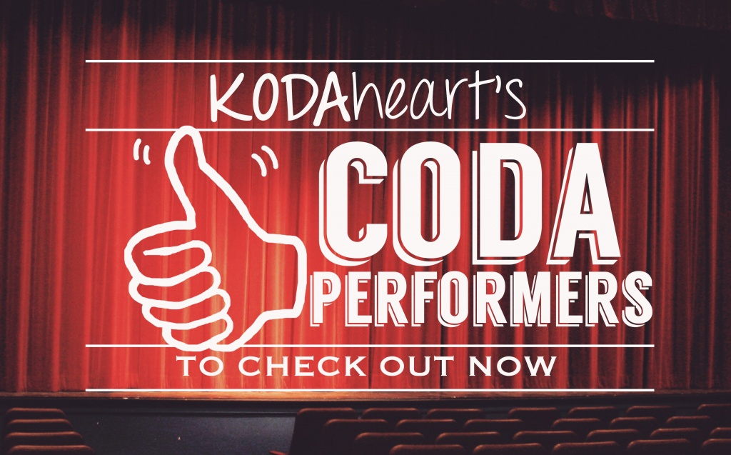 "[Image Description: A thumb, outlined in black, signs ""10"" with accompanying text that reads: ""KODAheart's [10] CODA performers to check out now"" In the background, rows of seats line the stage of a theatre.]"