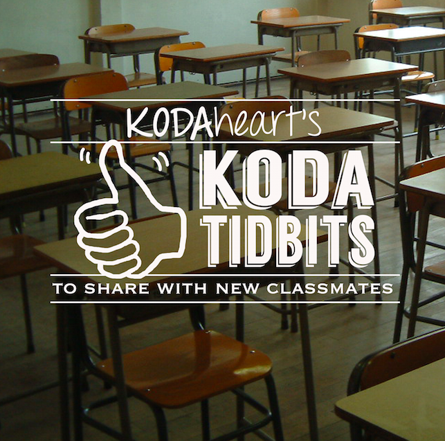 "[Image Description: A thumb, outlined in white, signs ""10"" with accompanying text that reads: ""KODAheart's [10] Tidbits to share with new classmates"" The background image is an angled photo of a classroom full of desks.]"