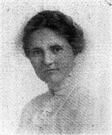 [Image Description: A black and white newspaper image of a young white woman, wearing early twentieth century, white shirt Her hair, in a braid, is piled atop her head. She looks out from the photograph with a serious expression.]