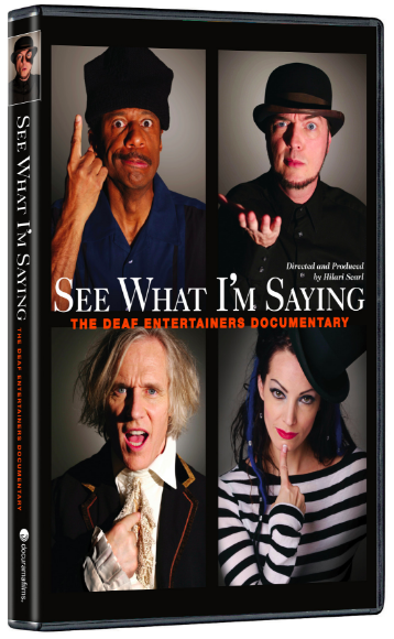 """[Image description: Movie cover for See What I'm Saying. Four images frame the cover. In the top left corner, a middle-age African-American male wearing a blue shirt and black hat is signing """"understand."""" In the top right corner a middle-age white male in a black shirt and black hat is signing """"what."""" In the bottom left corner an older white male in a blue jacket and white undershirt is signing """"I."""" In the bottom right corner a white female in a black and white striped shirt and black top hat is signing """"say."""" Across the center of the cover, white text reads, """"See What I'm Saying"""" and red text below reads, """"The Deaf Entertainers Documentary.""""]"""