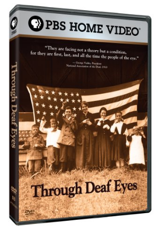 """[Image description: DVD cover for Through Deaf Eyes. A sepia-toned photo of a group of people, mostly children, standing in front of a large American flag. Their hands are frozen in sign language. Black text on the bottom of the image reads, """"Through Deaf Eyes.""""]"""