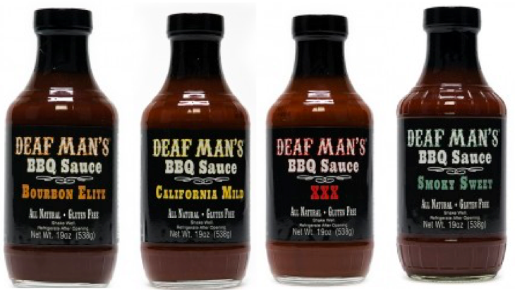 """[IImage description: 4 BBQ bottles are side by side. Each with a black label that states in different color writing """"Deaf Man's BBQ sauce."""" From left to right the four flavors are Bourbon Elite, California Mold, XXX, & Smoky Sweet.]"""