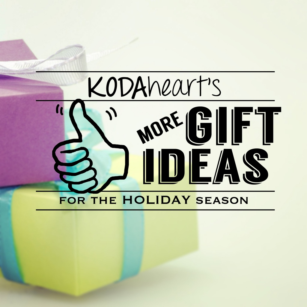 """[Image Description: A thumb, outlined in black, signs """"10"""" with accompanying text that reads: """"KODAheart's [10] More Gift Ideas for the Holiday Season."""" In the background, a present wrapped in purple paper with a white bow lays on top of a present wrapped in yellow paper with a blue blow.]"""