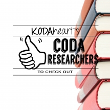"[Image Description: A thumb, outlined in white on a black background signs ""10"" with accompanying text that reads: ""KODAheart's [10] Coda Researchers to Check Out."" The background is white with a stack of different colored hardcover books to the right.]"