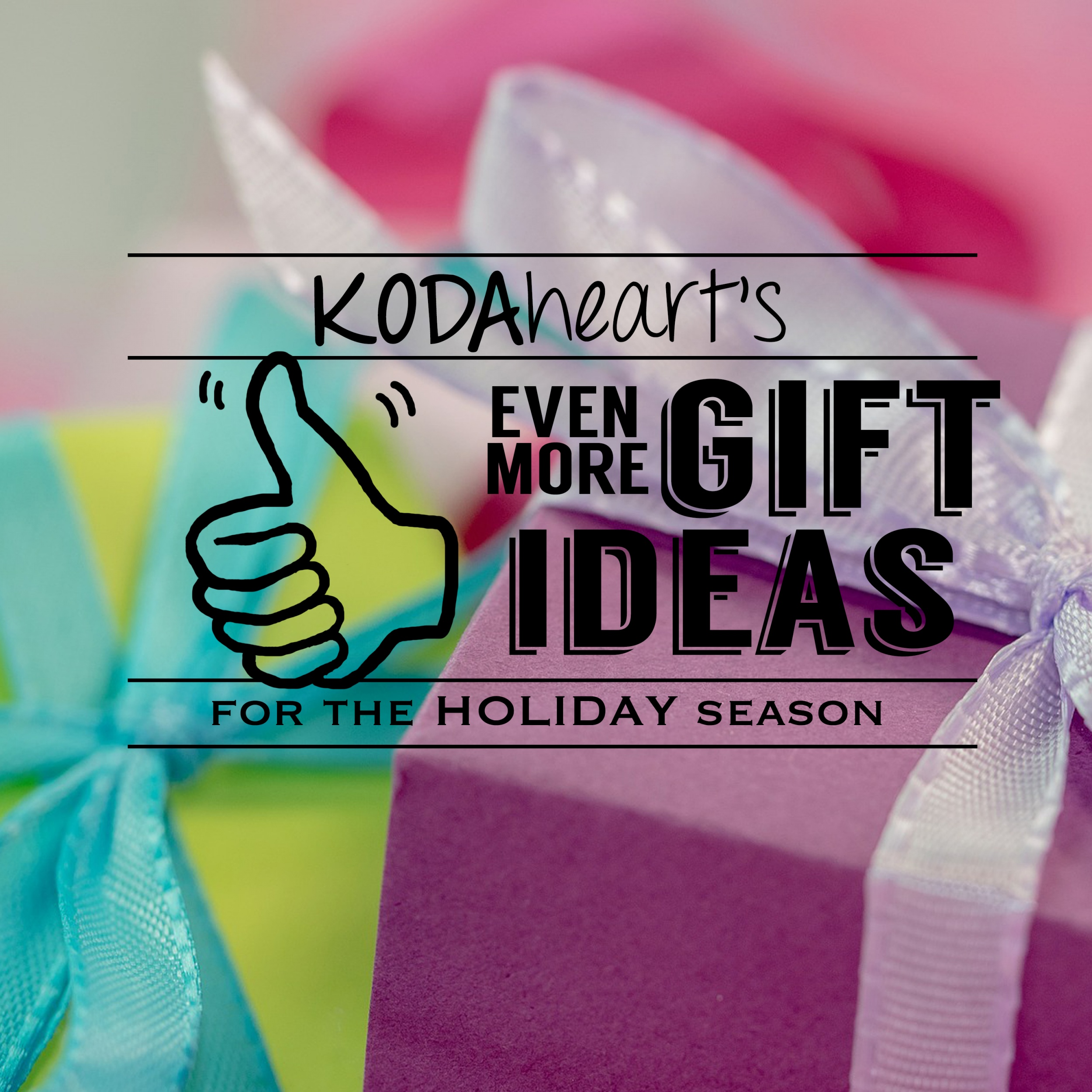 """[Image description: A thumb, outlined in black, signs """"10"""" with accompanying text that reads: """"KODAheart's [10] Even more gift ideas for the holiday season."""" In the background is a closeup colorfully wrapped boxes with ribbon bows.]"""