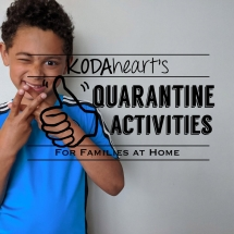 """[Image Description: A young boy in a blue Adidas t-shirt smiles while signing the word 'quarantine'. Text to the right reads """"KODAheart's [10] things to do during Quarantine""""]"""